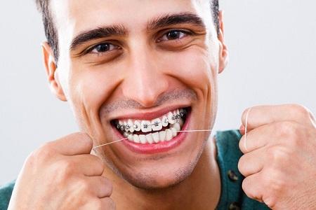 باید از نخ دندان هم استفاده کنم؟