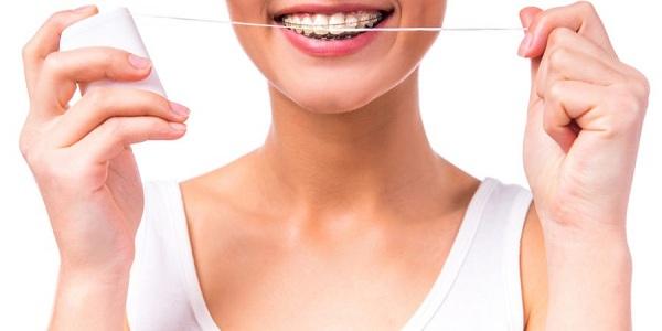 نخ دندان برای دندان های ارتودنسی شده